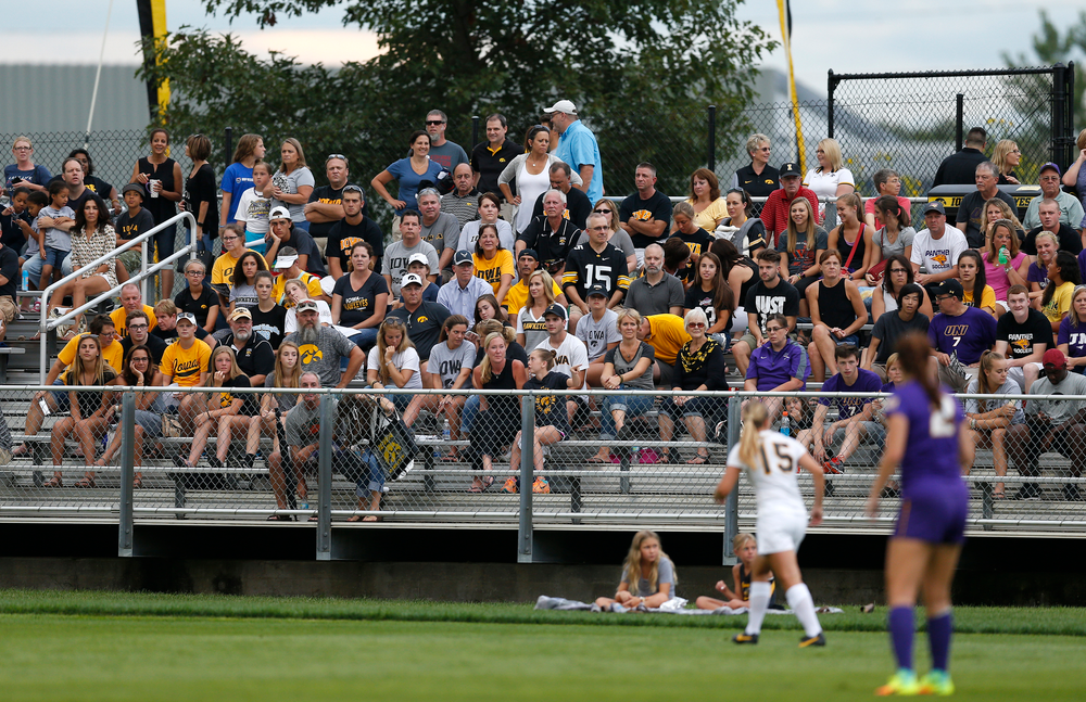 Fans watch as the Iowa Hawkeyes take on UNI