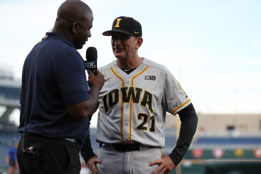 Iowa Hawkeyes head coach Rick Heller talks with Danan Hughes following their game against the Indiana Hoosiers in the first round of the Big Ten Baseball Tournament Wednesday, May 22, 2019 at TD Ameritrade Park in Omaha, Neb. (Brian Ray/hawkeyesports.com)