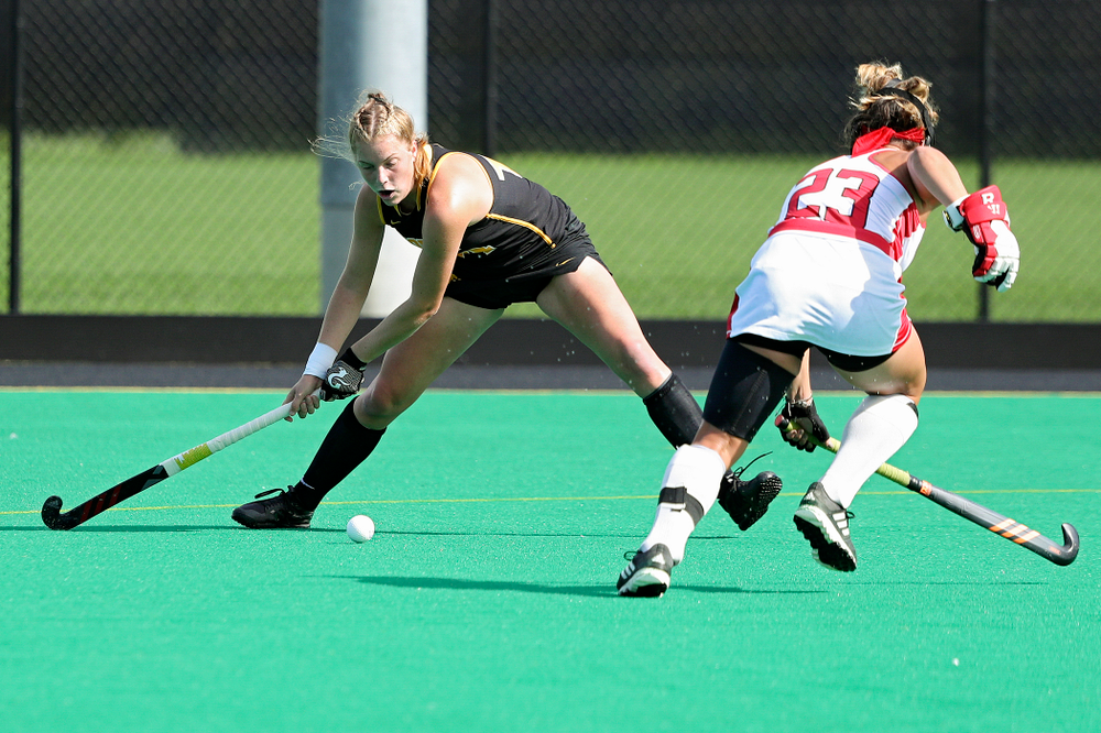Iowa's Lokke Stribos (14) scores a goal during the first quarter of their match at Grant Field in Iowa City on Friday, Oct 4, 2019. (Stephen Mally/hawkeyesports.com)