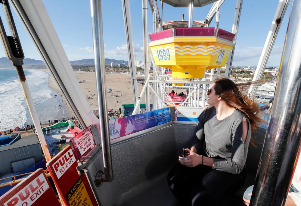 Iowa Hawkeyes forward Megan Gustafson (10) rides the ferris wheel in Pacific Park on the Santa Monica Pier Thursday, March 15, 2018 in Santa Monica. (Brian Ray/hawkeyesports.com)