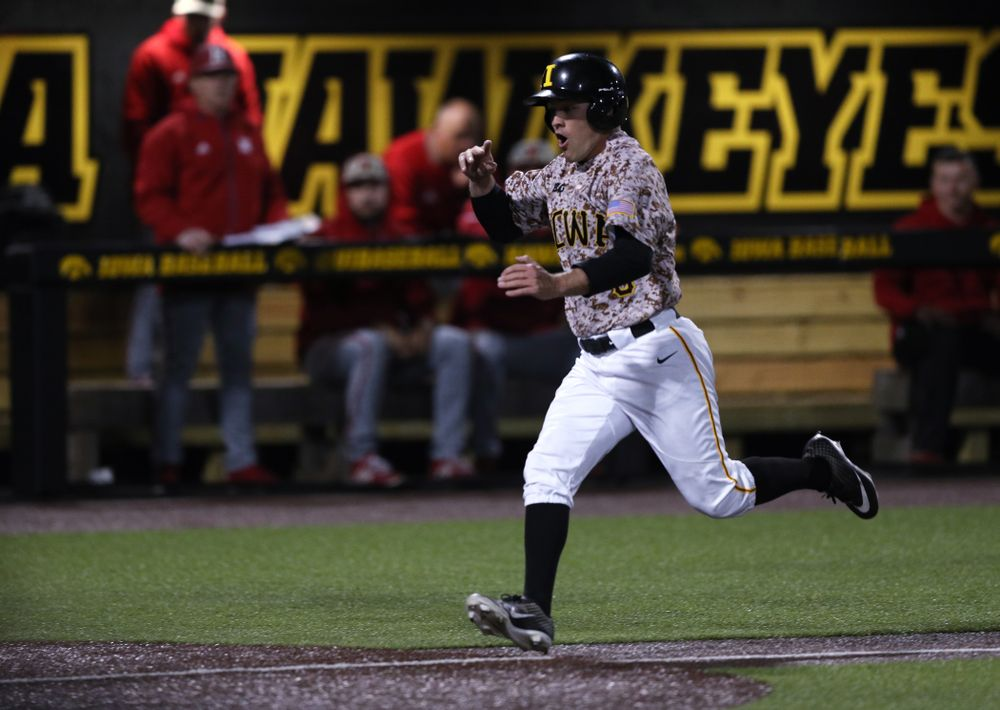 Iowa Hawkeyes outfielder Justin Jenkins (6) scores the game winning run in the bottom of the 9th against the Nebraska Cornhuskers on Military Appreciation Night Friday, April 19, 2019 at Duane Banks Field. (Brian Ray/hawkeyesports.com)