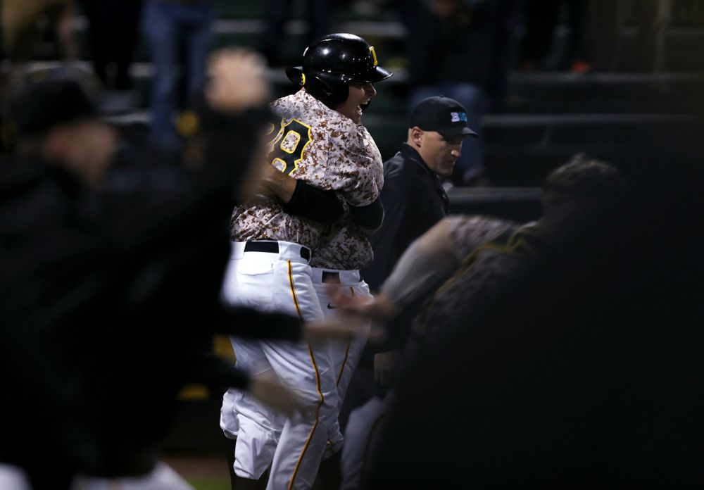 Iowa Hawkeyes Chris Whelan (28) celebrates their walk off win against the Nebraska Cornhuskers on Military Appreciation Night Friday, April 19, 2019 at Duane Banks Field. (Brian Ray/hawkeyesports.com)