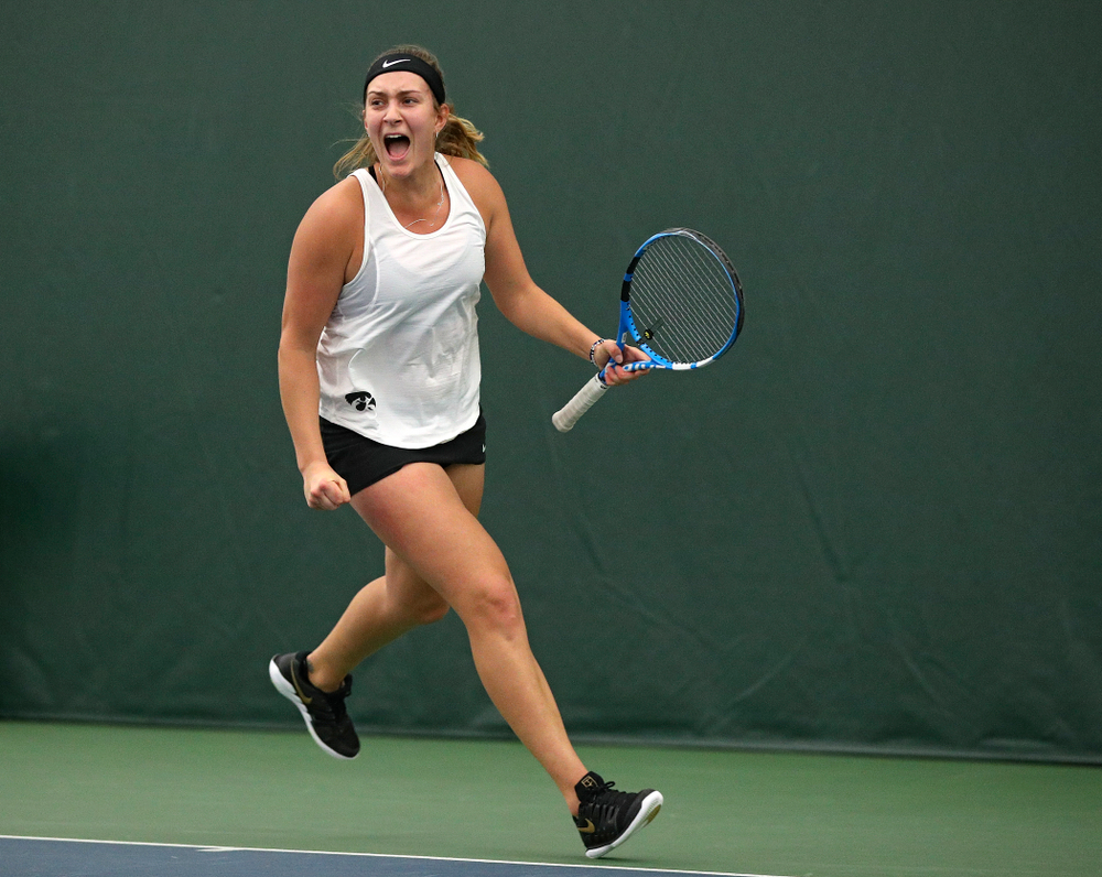 Iowa's Ashleigh Jacobs celebrates a point during her doubles match at the Hawkeye Tennis and Recreation Complex in Iowa City on Sunday, February 23, 2020. (Stephen Mally/hawkeyesports.com)