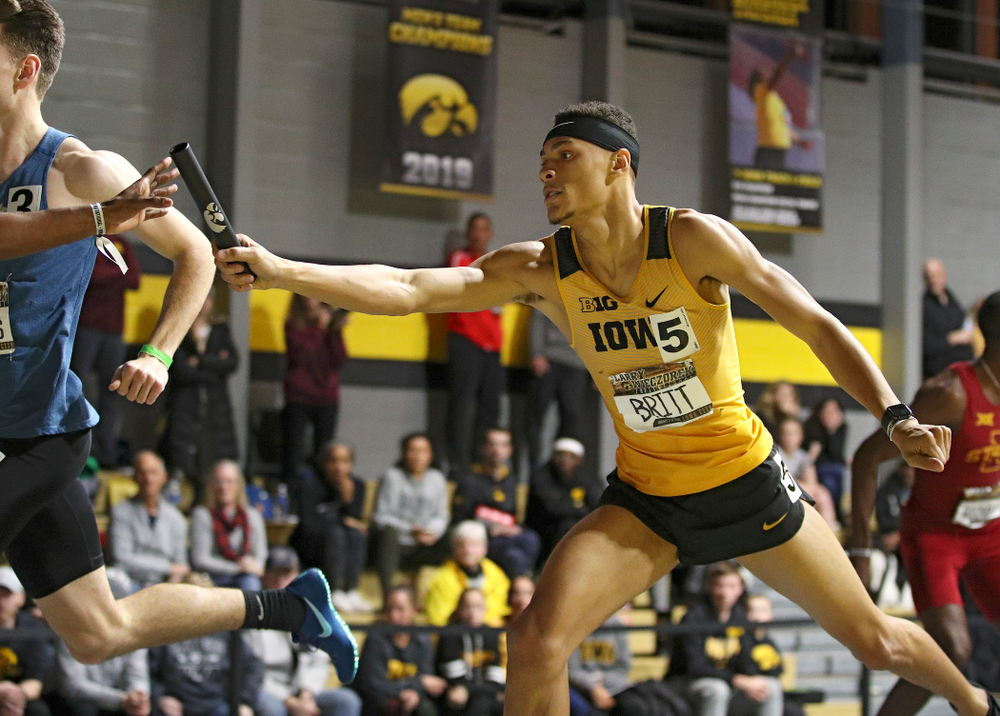 Iowa's Jamal Britt hands off the baton as they run the men's 1600 meter relay premier event during the Larry Wieczorek Invitational at the Recreation Building in Iowa City on Saturday, January 18, 2020. (Stephen Mally/hawkeyesports.com)
