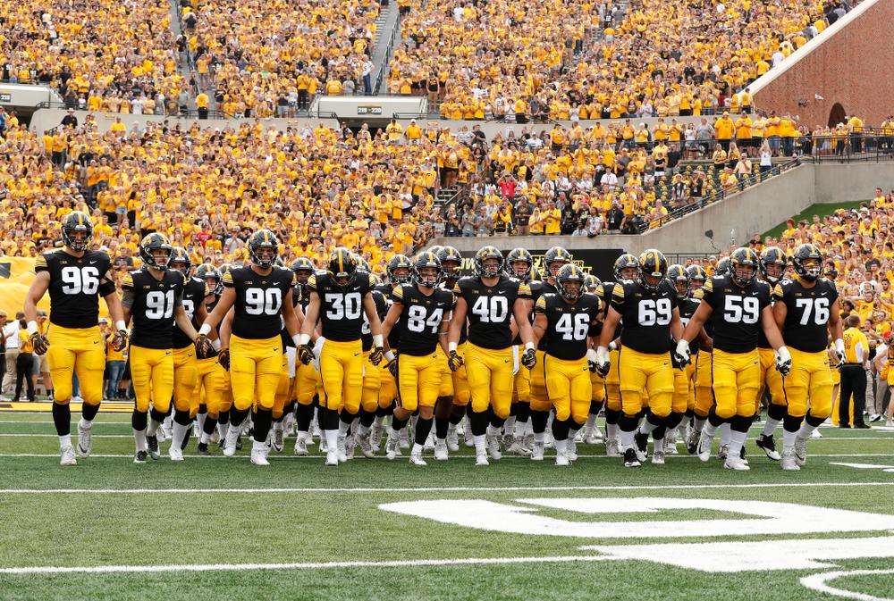 The Iowa Hawkeyes swarm onto the field against the Northern Illinois Huskies Saturday, September 1, 2018 at Kinnick Stadium. (Brian Ray/hawkeyesports.com)