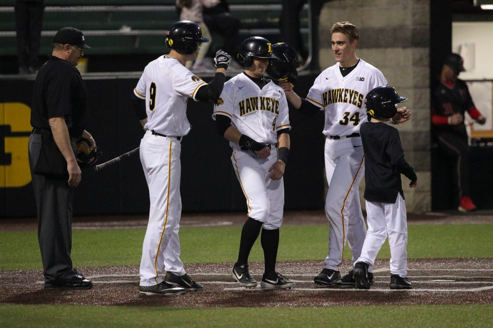 Iowa outfielder Ben Norman (9), Iowa infielder Mitchell Boe (4), Iowa catcher Austin Martin (34) at the game 1 vs Rutgers on Friday, April 5, 2019 at Duane Banks Field. (Lily Smith/hawkeyesports.com)