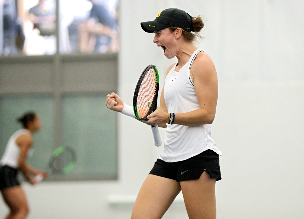 Iowa's Elise Van Heuvelen celebrates a point during her doubles match at the Hawkeye Tennis and Recreation Complex in Iowa City on Sunday, February 16, 2020. (Stephen Mally/hawkeyesports.com)