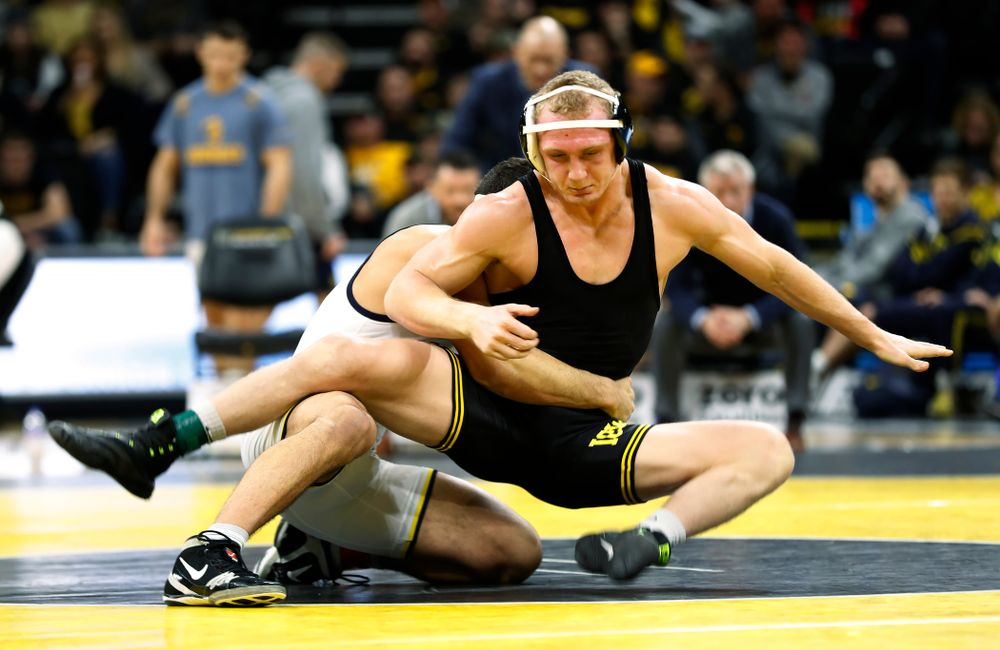 Iowa's Kaleb Young against Michigan's Myles Amine at 174 pounds