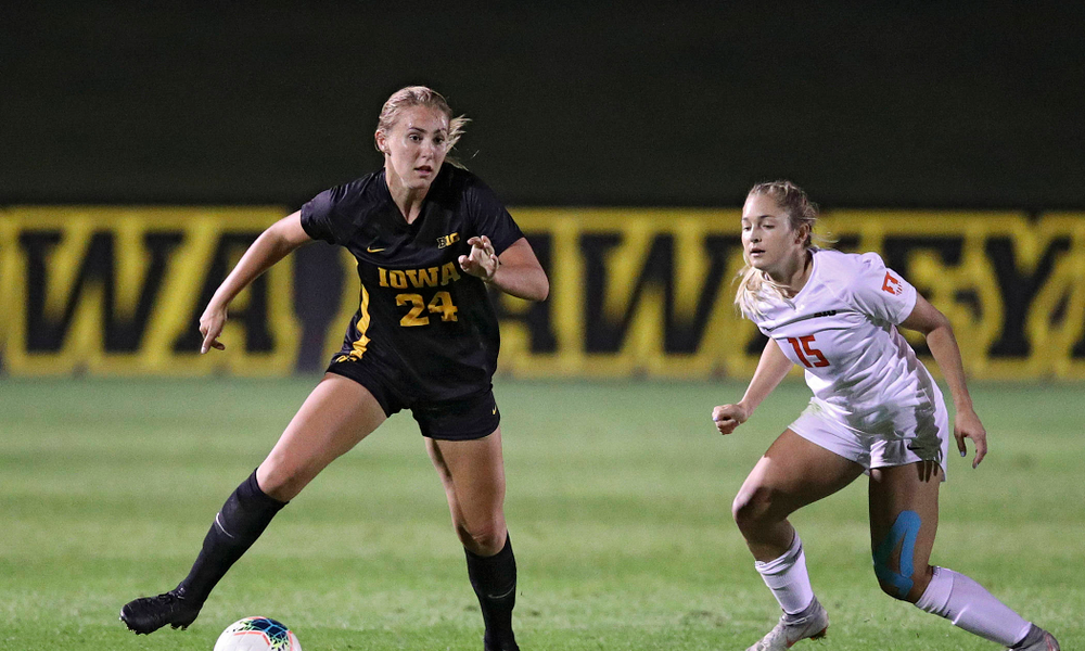 Iowa defender Sara Wheaton (24) gets around a defender during the second half of their match against Illinois at the Iowa Soccer Complex in Iowa City on Thursday, Sep 26, 2019. (Stephen Mally/hawkeyesports.com)