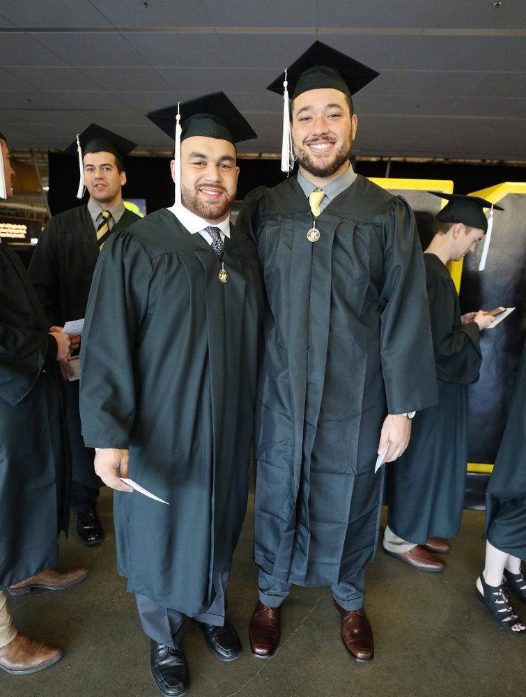 Iowa Football's Austin Kelly and Dalton Ferguson during the Fall Commencement Ceremony  Saturday, December 15, 2018 at Carver-Hawkeye Arena. (Brian Ray/hawkeyesports.com)