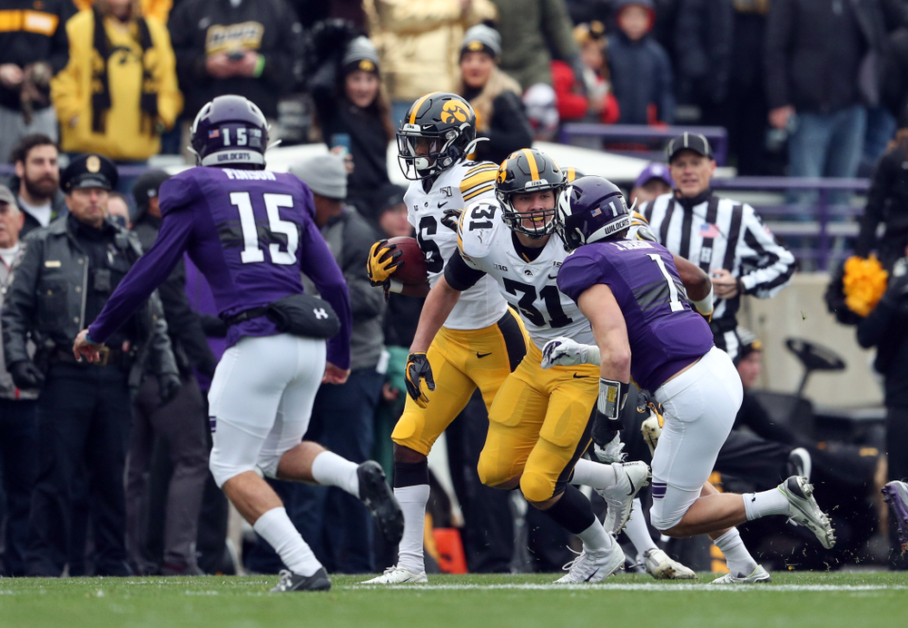 Iowa Hawkeyes wide receiver Ihmir Smith-Marsette (6) and linebacker Jack Campbell (31) against the Northwestern Wildcats Saturday, October 26, 2019 at Ryan Field in Evanston, Ill. (Brian Ray/hawkeyesports.com)