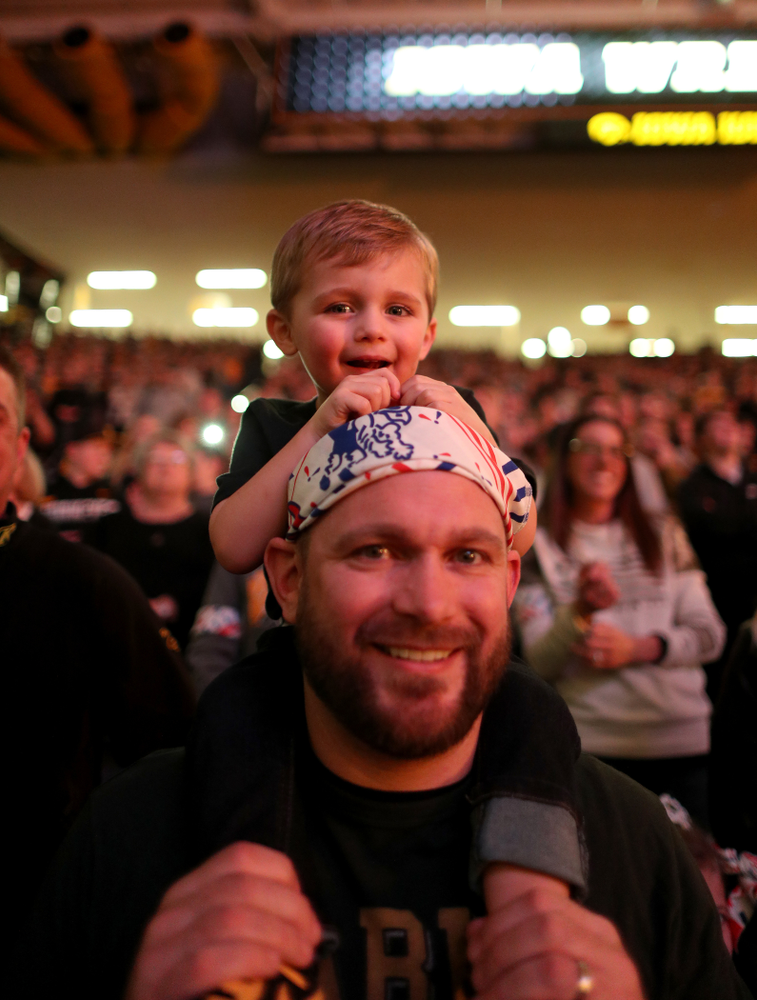 A young fan cheers on the Iowa Hawkeyes before their meet against Nebraska Saturday, January 18, 2020 at Carver-Hawkeye Arena. Assad won the match 6-4. (Brian Ray/hawkeyesports.com)