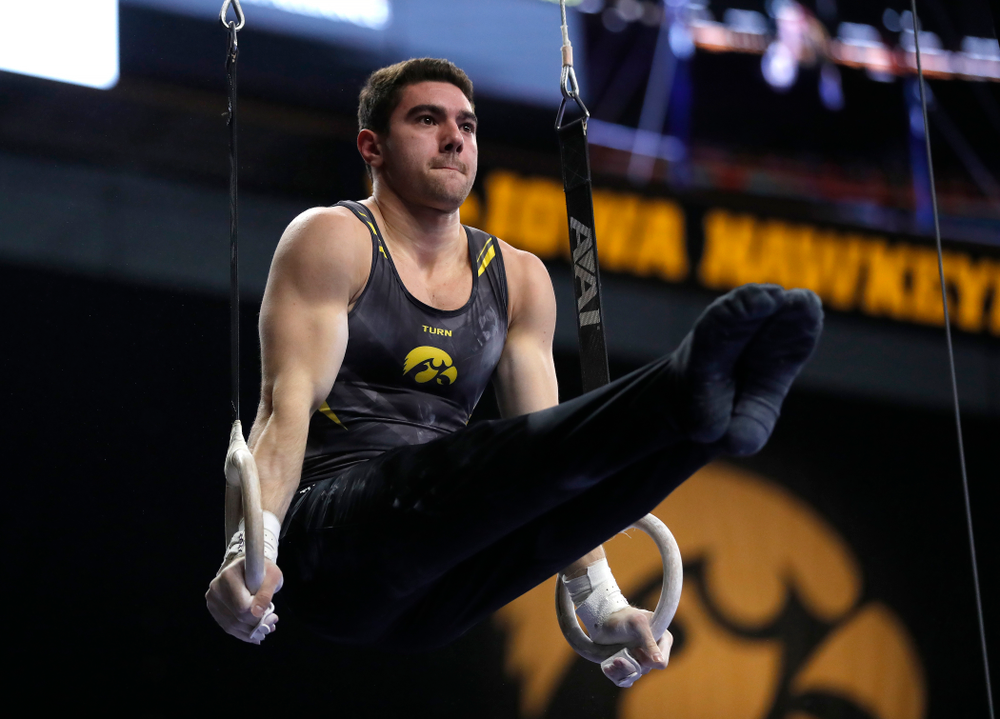 Dominic Tommaso competes on the rings against Illinois