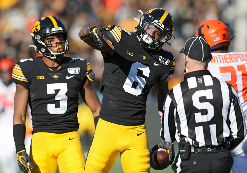 Iowa Hawkeyes wide receiver Ihmir Smith-Marsette (6) signals first down after pulling in a pass during the third quarter of their game at Kinnick Stadium in Iowa City on Saturday, Nov 23, 2019. (Stephen Mally/hawkeyesports.com)