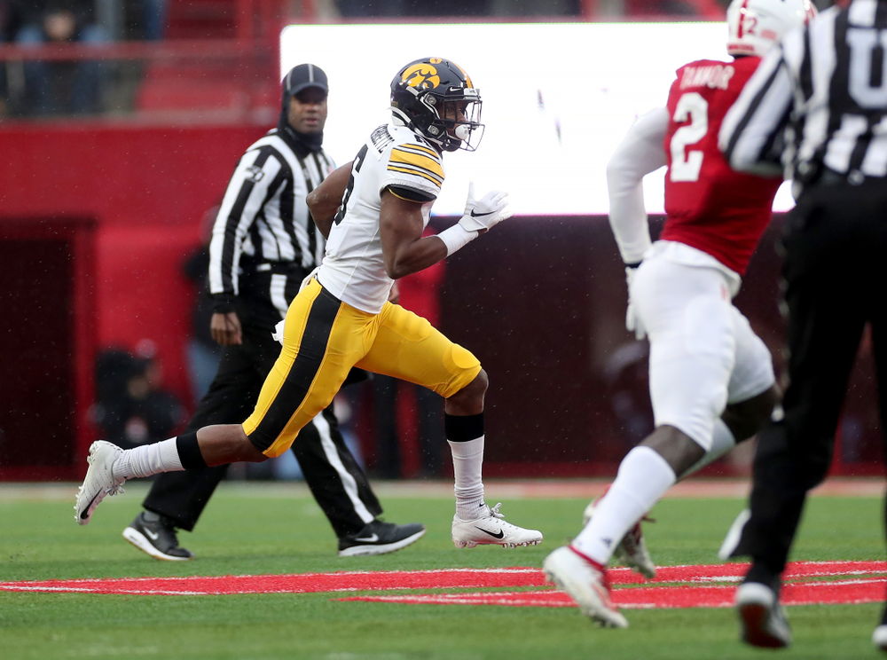 Iowa Hawkeyes wide receiver Ihmir Smith-Marsette (6) breaks free on a long touchdown run against the Nebraska Cornhuskers Friday, November 29, 2019 at Memorial Stadium in Lincoln, Neb. (Brian Ray/hawkeyesports.com)