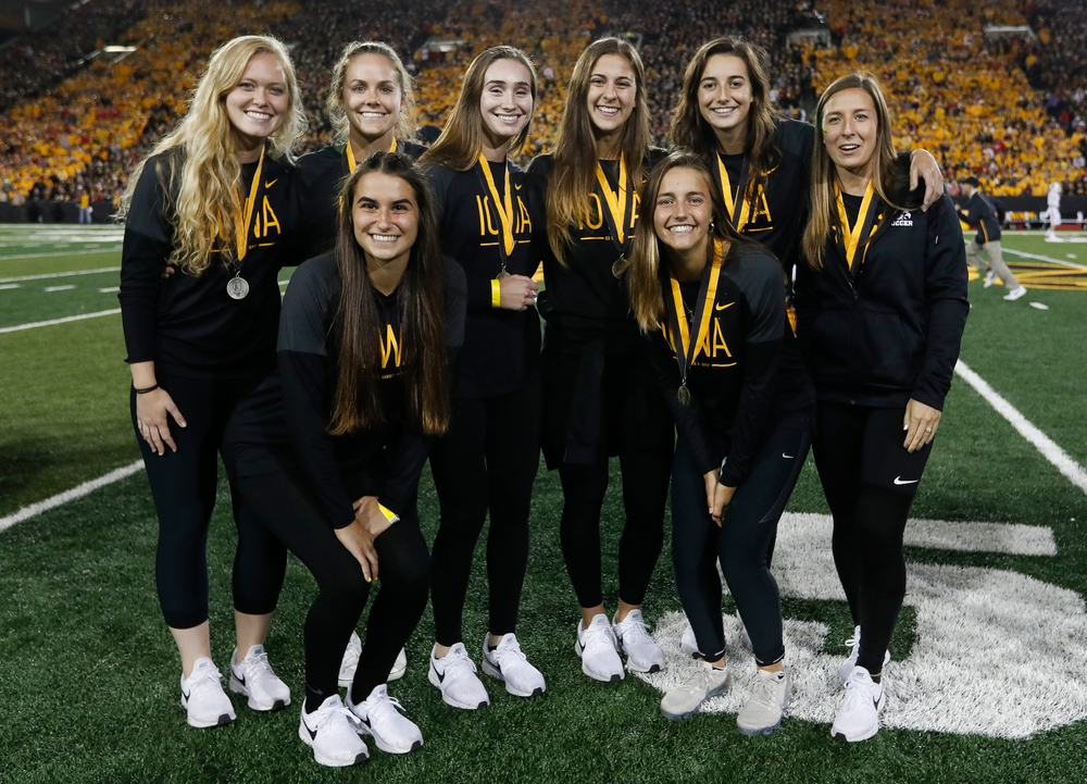 Members of the Iowa soccer team are recognized by the Presidential Committee on Athletics at halftime during a game against Wisconsin on September 22, 2018. (Tork Mason/hawkeyesports.com)