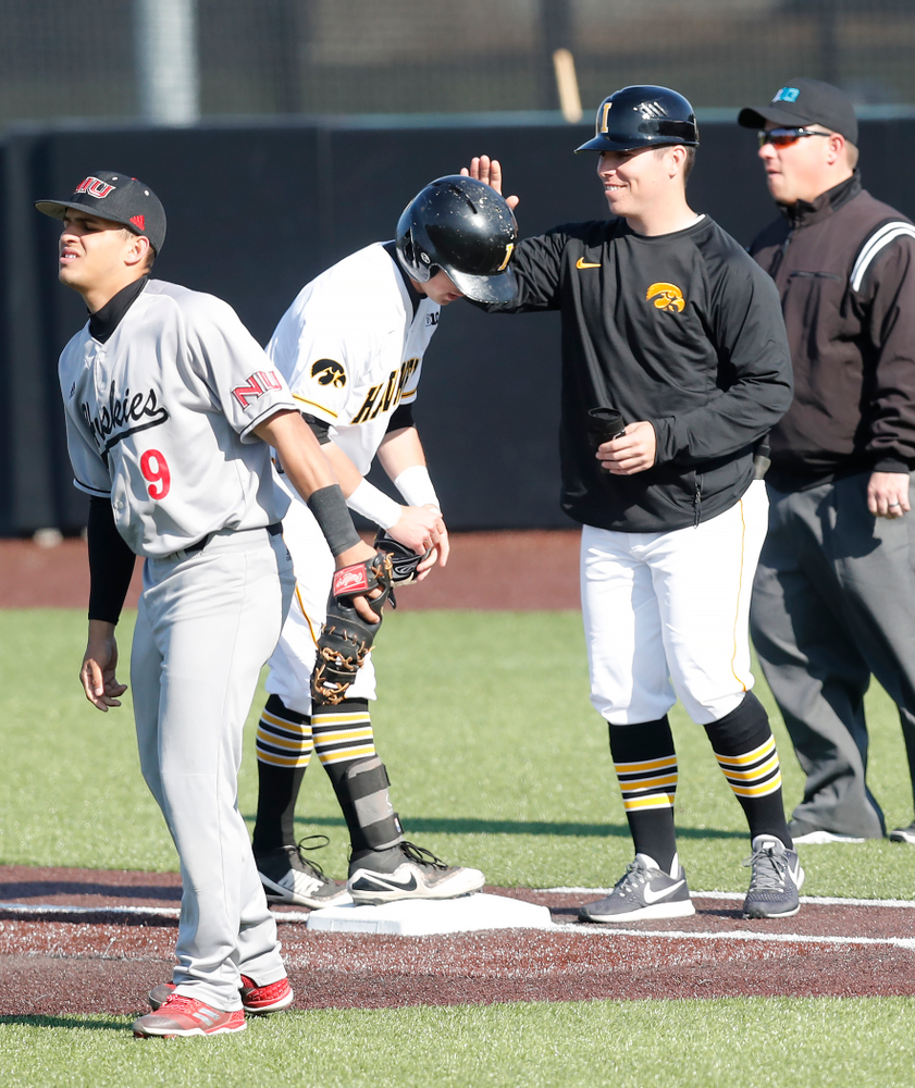 Iowa Hawkeyes infielder Mitchell Boe (4) and volunteer coach Sean Moore against Northern Illinois Tuesday, April 17, 2018 at Duane Banks Field. (Brian Ray/hawkeyesports.com)