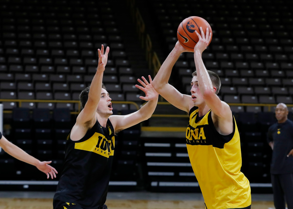 Iowa Hawkeyes forward Nicholas Baer (51) defends guard Joe Wieskamp (10) during the first practice of the season Monday, October 1, 2018 at Carver-Hawkeye Arena. (Brian Ray/hawkeyesports.com)