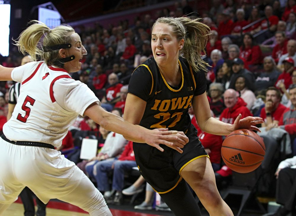 Iowa guard Kathleen Doyle (22) drives with the ball during the first quarter of their game at the Rutgers Athletic Center in Piscataway, N.J. on Sunday, March 1, 2020. (Stephen Mally/hawkeyesports.com)