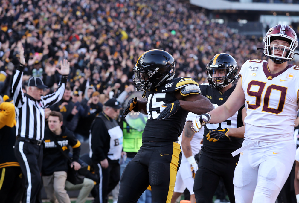 Iowa Hawkeyes running back Tyler Goodson (15) celebrates a touchdown against the Minnesota Golden Gophers Saturday, November 16, 2019 at Kinnick Stadium. (Brian Ray/hawkeyesports.com)