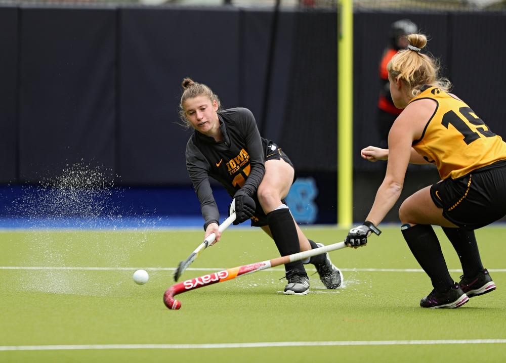 Iowa's Esme Gibson (15) tries to pass around Ryley Miller (19) during their practice at Karen Shelton Stadium in Chapel Hill, N.C. on Thursday, Nov 14, 2019. (Stephen Mally/hawkeyesports.com)