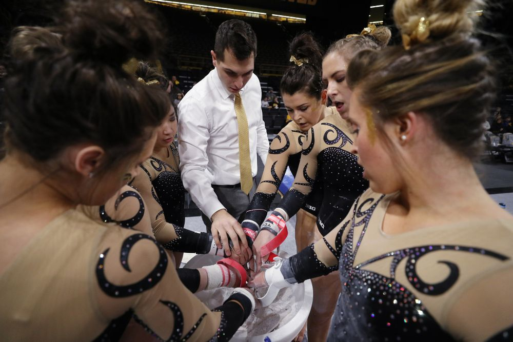 Iowa assistant coach Vince Smurro talks with his group before they compete on the bars during their meet against Southeast Missouri State Friday, January 11, 2019 at Carver-Hawkeye Arena. (Brian Ray/hawkeyesports.com)