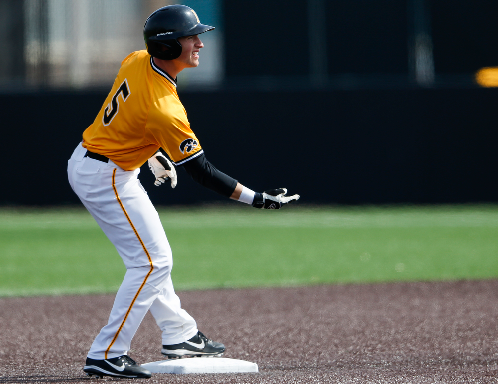 Iowa Hawkeyes catcher Tyler Cropley (5) reacts after hitting a double during a game against Evansville at Duane Banks Field on March 18, 2018. (Tork Mason/hawkeyesports.com)