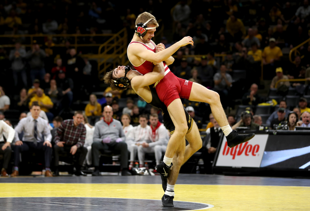 IowaÕs Austin DeSanto wrestles WisconsinÕs  Seth Gross at 133 pounds Sunday, December 1, 2019 at Carver-Hawkeye Arena. DeSanto won the match 6-2. (Brian Ray/hawkeyesports.com)