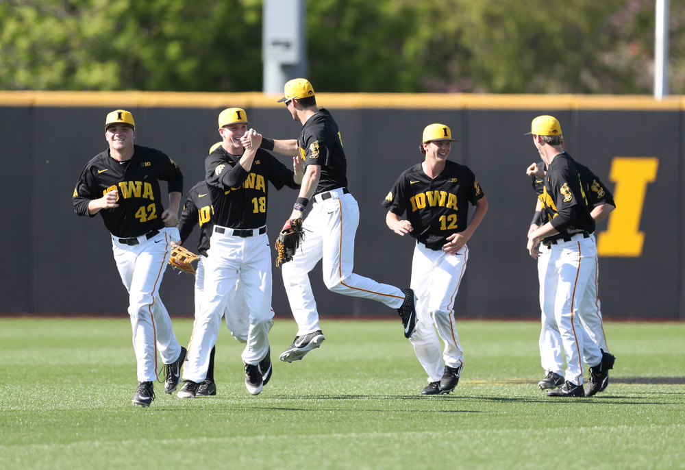Iowa Hawkeyes Shane Ritter (18) and outfielder Ben Norman (9) celebrate after winning game two against UC Irvine Saturday, May 4, 2019 at Duane Banks Field. (Brian Ray/hawkeyesports.com)