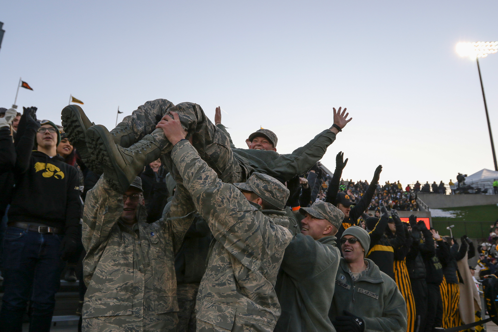 U.S. Service Members participate in the Pancheros Burrito Lift during Iowa football vs Minnesota on Saturday, November 16, 2019 at Kinnick Stadium. (Lily Smith/hawkeyesports.com)