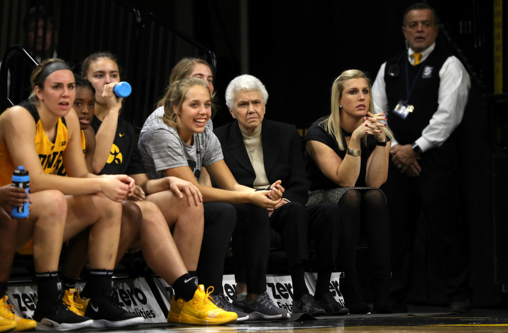 Dr. Christine Grant sits on the Iowa Hawkeyes bench during their game  against the Robert Morris Colonials Sunday, December 2, 2018 at Carver-Hawkeye Arena. (Brian Ray/hawkeyesports.com)