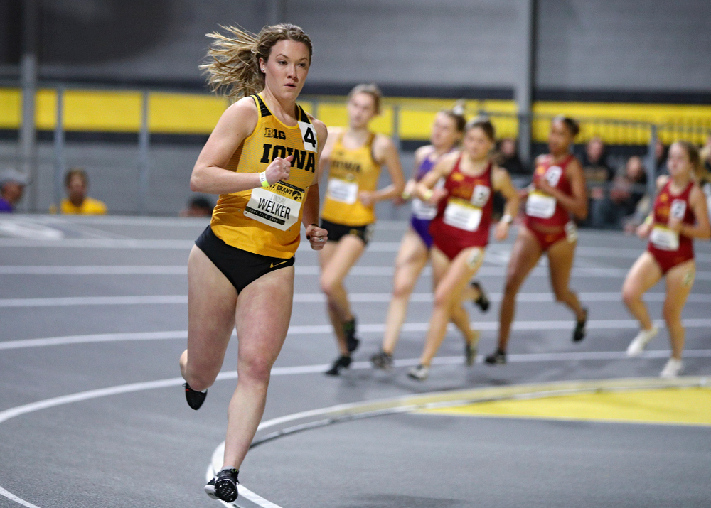 Iowa's Lindsay Welker runs the women's 1000 meter run event during the Jimmy Grant Invitational at the Recreation Building in Iowa City on Saturday, December 14, 2019. (Stephen Mally/hawkeyesports.com)