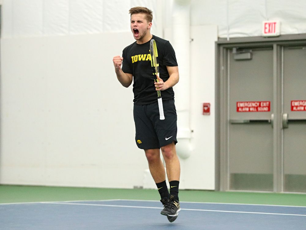 Iowa's Will Davies celebrates after winning his singles match at the Hawkeye Tennis and Recreation Complex in Iowa City on Friday, February 14, 2020. (Stephen Mally/hawkeyesports.com)