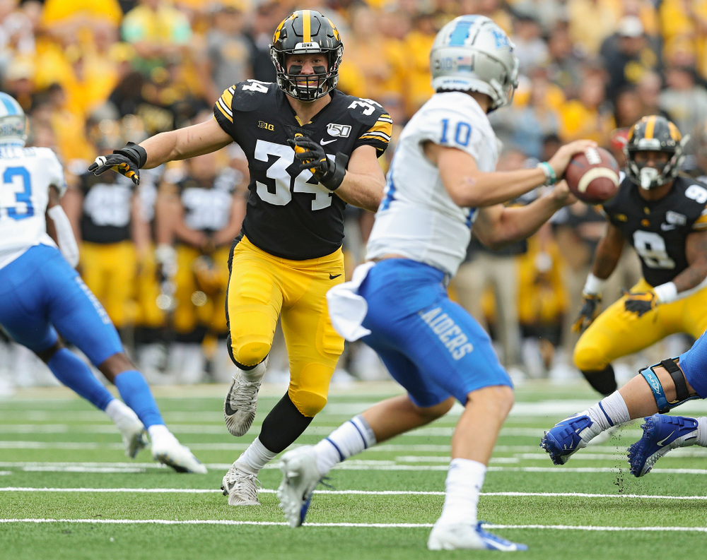Iowa Hawkeyes linebacker Kristian Welch (34) closes in on Middle Tennessee State quarterback Asher O'Hara (10) during the first quarter of their game at Kinnick Stadium in Iowa City on Saturday, Sep 28, 2019. (Stephen Mally/hawkeyesports.com)