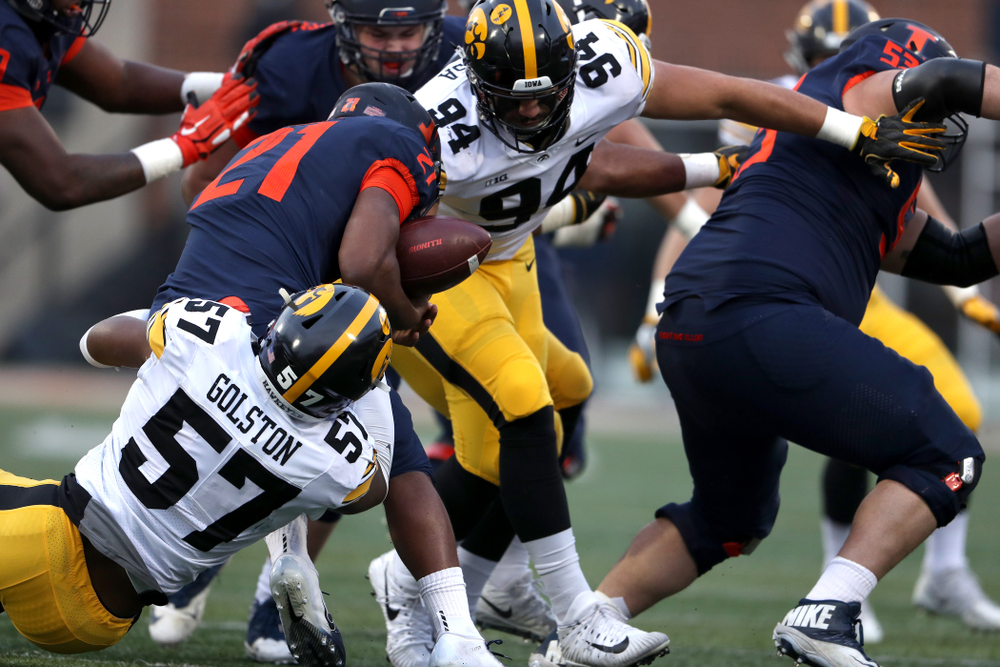Iowa Hawkeyes defensive end A.J. Epenesa (94) and defensive end Chauncey Golston (57) cause a fumble against the Illinois Fighting Illini Saturday, November 17, 2018 at Memorial Stadium in Champaign, Ill. (Brian Ray/hawkeyesports.com)