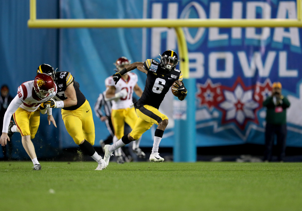 Iowa Hawkeyes wide receiver Ihmir Smith-Marsette (6) returns a kick for a touchdown against USC in the Holiday Bowl Friday, December 27, 2019 at San Diego Community Credit Union Stadium.  (Brian Ray/hawkeyesports.com)