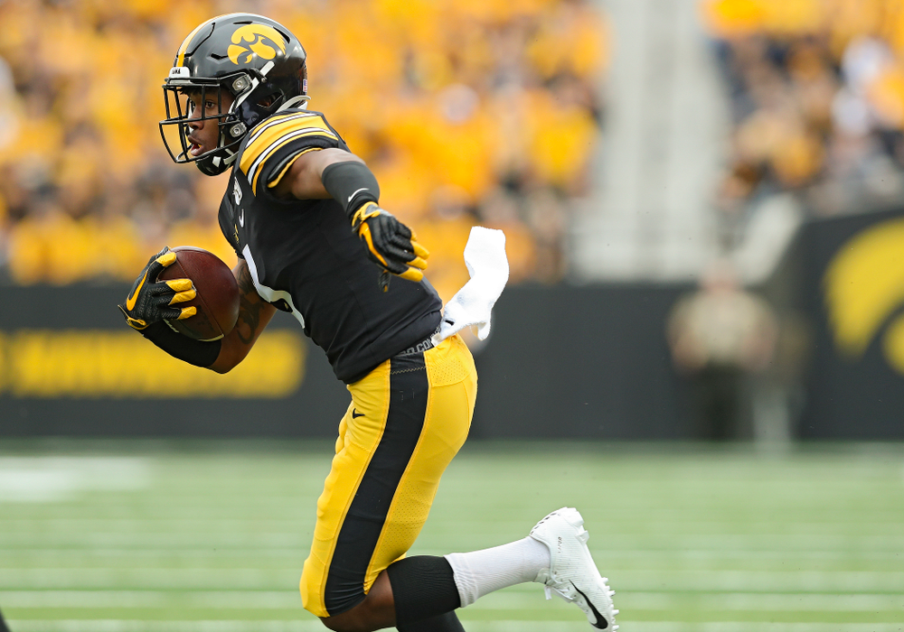 Iowa Hawkeyes wide receiver Tyrone Tracy Jr. (3) runs after pulling in a pass during the first quarter of their game at Kinnick Stadium in Iowa City on Saturday, Sep 28, 2019. (Stephen Mally/hawkeyesports.com)