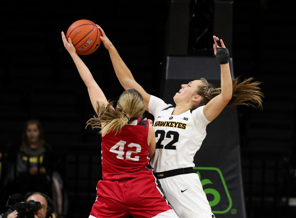 Iowa Hawkeyes guard Kathleen Doyle (22) blocks a shot against the IUPUI Jaguars Saturday, December 8, 2018 at Carver-Hawkeye Arena. (Brian Ray/hawkeyesports.com)