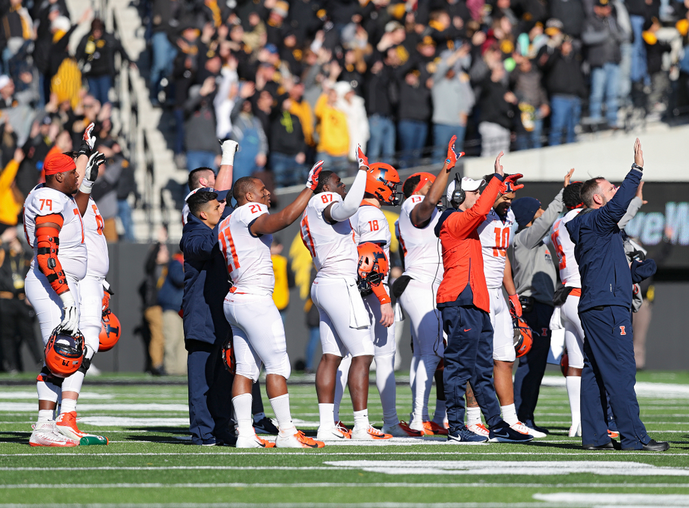 Illinois Fighting Illini players and staff wave to the University of Iowa Stead Family Children's Hospital between the first and second quarter of their game at Kinnick Stadium in Iowa City on Saturday, Nov 23, 2019. (Stephen Mally/hawkeyesports.com)