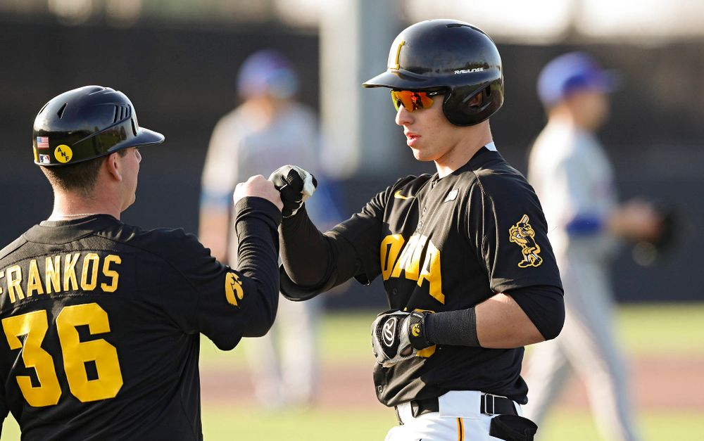 Iowa catcher Tyler Snep (16) gets a fist bump from volunteer assistant Jimmy Frankos after getting a hit during the fourth inning of their college baseball game at Duane Banks Field in Iowa City on Tuesday, March 10, 2020. (Stephen Mally/hawkeyesports.com)