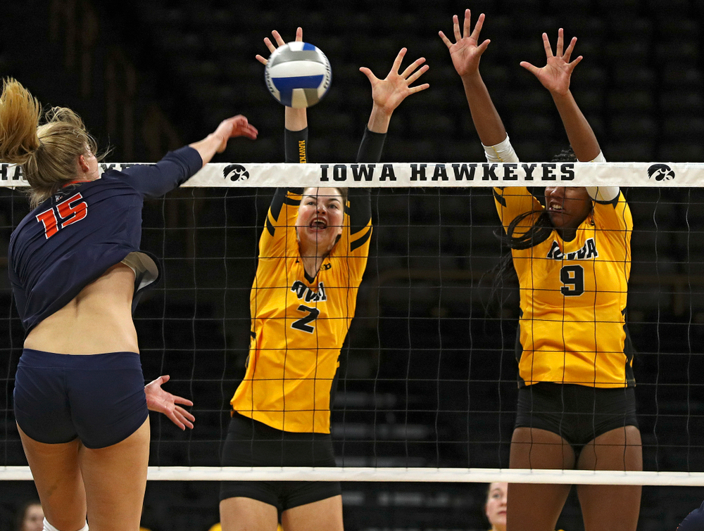 Iowa's Courtney Buzzerio (2) blocks a shot as Amiya Jones (9) looks on during the third set of their match against Illinois at Carver-Hawkeye Arena in Iowa City on Wednesday, Nov 6, 2019. (Stephen Mally/hawkeyesports.com)
