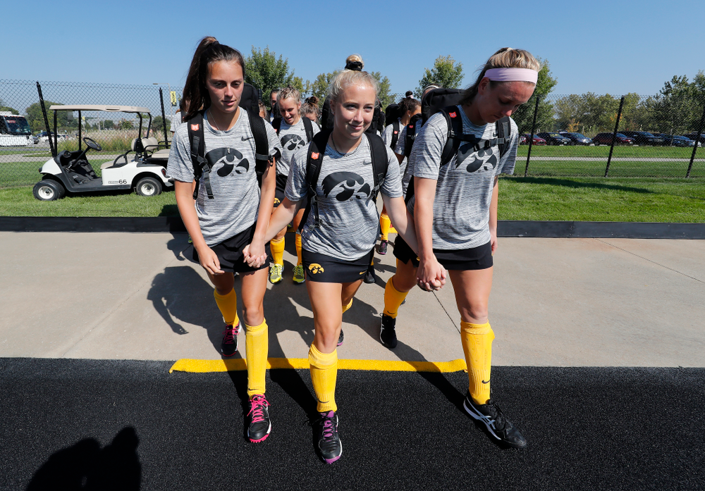 The Seniors cross the line before their game  against Indiana Sunday, September 16, 2018 at Grant Field. (Brian Ray/hawkeyesports.com)