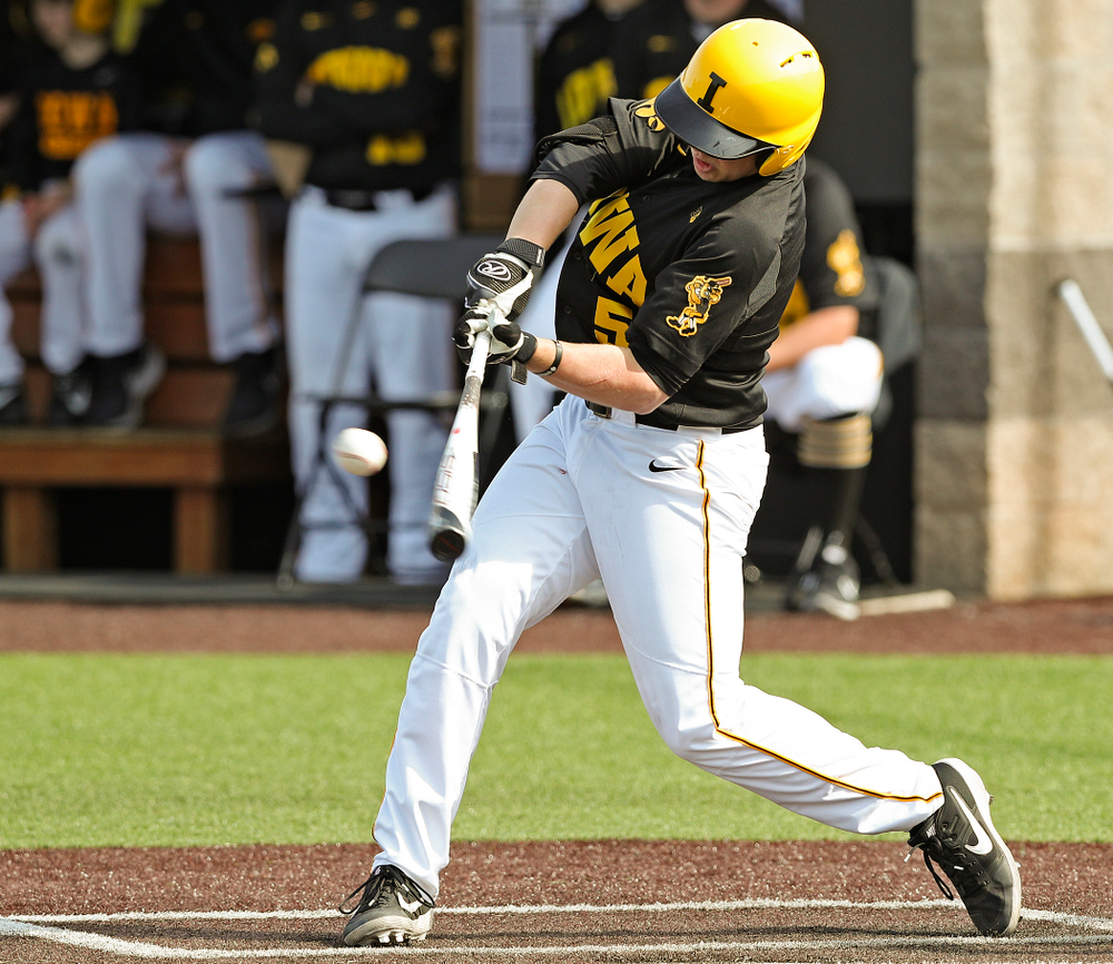 Iowa Hawkeyes first baseman Zeb Adreon (5) hits an RBI single during the sixth inning of their game against Rutgers at Duane Banks Field in Iowa City on Saturday, Apr. 6, 2019. (Stephen Mally/hawkeyesports.com)
