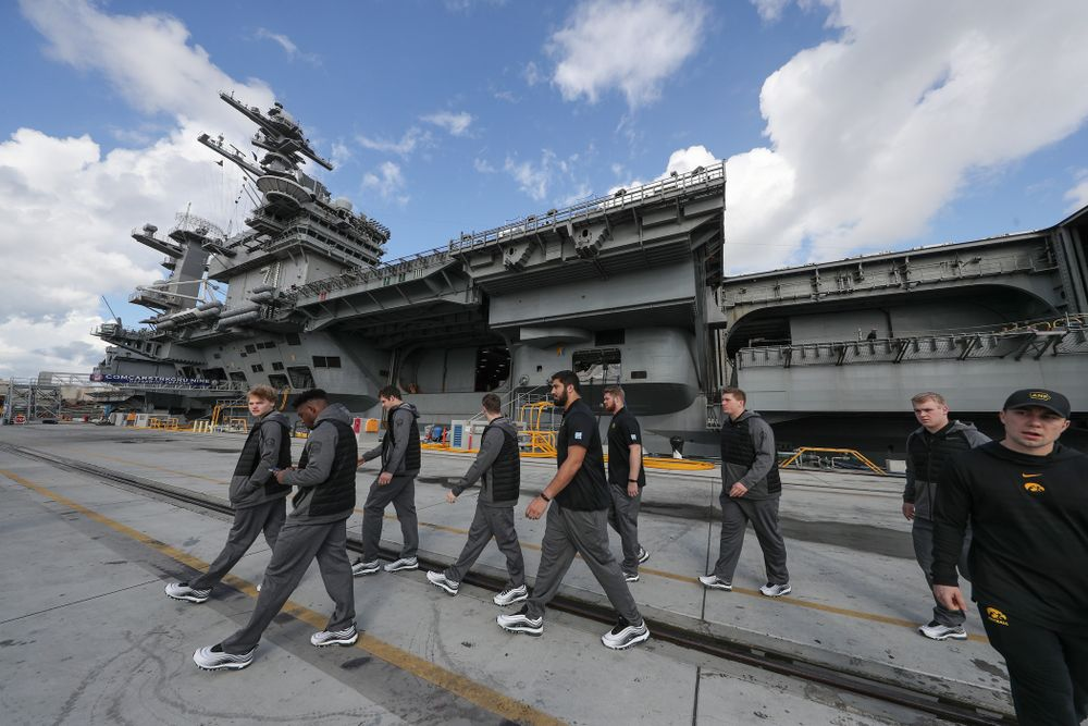 Members of the Iowa Hawkeyes leave the USS Theodore Roosevelt (CVN-71) Tuesday, December 24, 2019 at the Naval Base Coronado (Brian Ray/hawkeyesports.com)