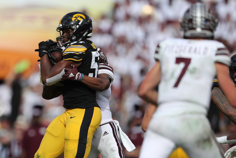 Iowa Hawkeyes defensive end Chauncey Golston (57) intercepts a pass during the Outback Bowl Tuesday, January 1, 2019 at Raymond James Stadium in Tampa, FL. (Brian Ray/hawkeyesports.com)
