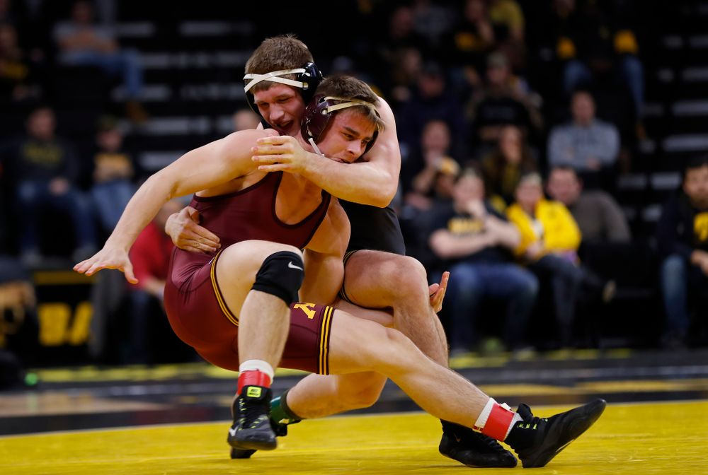 Iowa's Cash Wilcke wrestles Minnesota's Dylan Anderson at 197 pounds