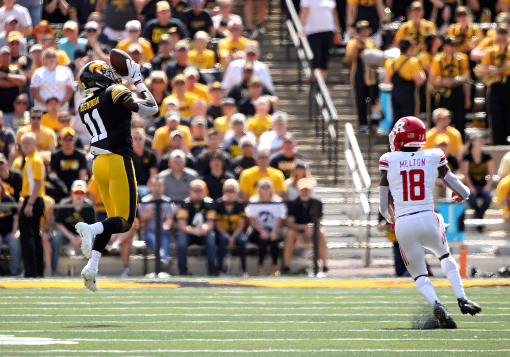 Iowa Hawkeyes defensive back Michael Ojemudia (11) pulls in an interception during the fourth quarter of their Big Ten Conference football game at Kinnick Stadium in Iowa City on Saturday, Sep 7, 2019. (Stephen Mally/hawkeyesports.com)