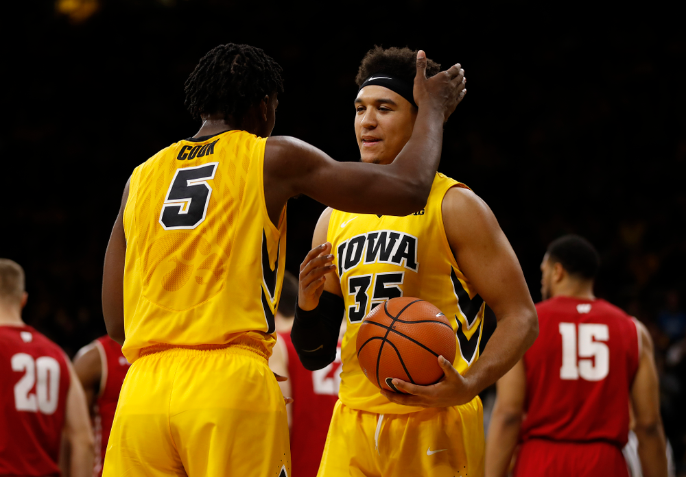 Iowa Hawkeyes forward Tyler Cook (5) and forward Cordell Pemsl (35)