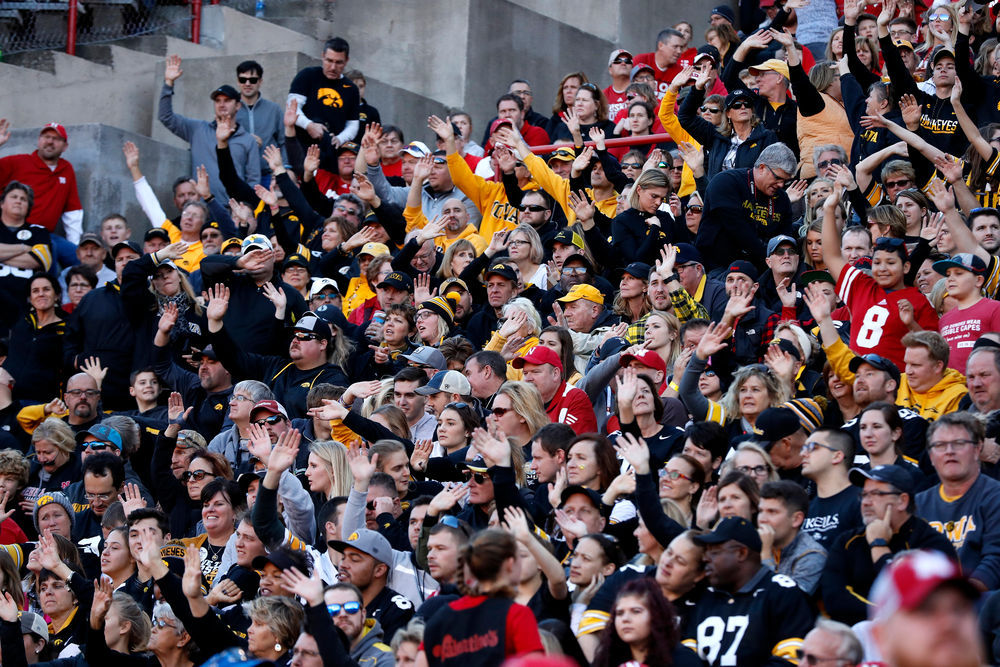 Fans of the Iowa Hawkeyes wave to the Stead Family Children's Hospital at the end of the first quarter