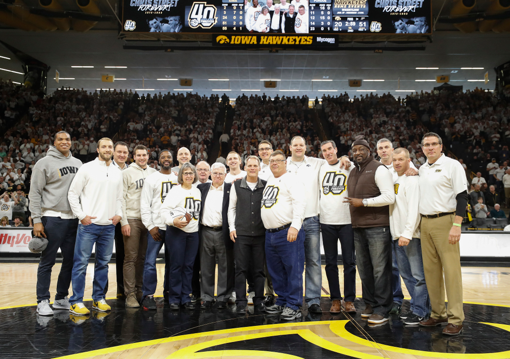 Mike and Patty Street, former head coach Tom Davis, former assistant coach Gary Close, teammates of Chris Street, and pas Chris Street Award Winners